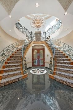 Grand staircase on pinterest stairways stairs and house for Inside amazing mansions