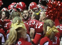 Marysville-Pilchuck's football team and cheerleaders celebrate their victory over Marysville Getchell Friday. See more of Seattle Times photographer Dean Rutz's photos from the game.