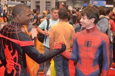 Ultimate Spider-man, Miles Morales, meets Spider-man, Peter Parker. Cosplayed by Rip Redwood and Aaron Rivin.
