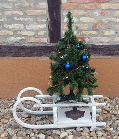 Christmas tree holder made from an old woode sledge
