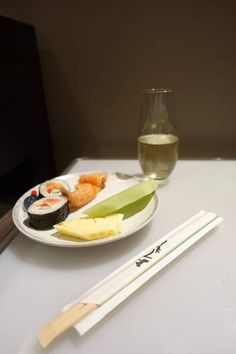 Plate of sushi and fruit, with a glass of Arras champagne in the Singapore Airlines Lounge in Perth.