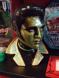 Gold Jacket with Turquoise Pinstriping Zombie Elvis Ceramic Bust. Shop: missluckyhellcatart