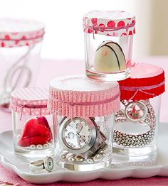 gift in votive holder topped with a muffin liner and ribbon. Can be applied to any holiday.