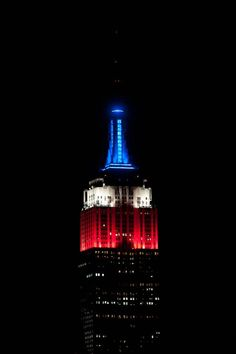 September 11, 2013: In memory of September 11, our lights will shine proudly in red, white and blue until sunrise. #Remember911 #NeverForget