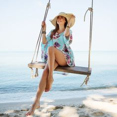 Outdoors lifestyle fashion portrait stunning young girl enjoying on swing on the tropical island. In the background the sea. Wearing stylish blue dress, straw hat and bracelets. Varicose Vein Removal, Varicose Veins, Enjoy Girl, Girl Swinging, Designs To Draw, Blue Dresses, Cover Up, Long Hair Styles, Stylish