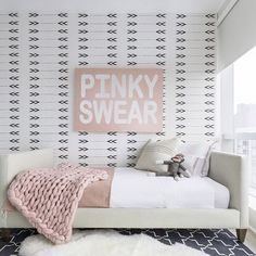 mommo design: GIRLS ROOMS // modern girls room with arrow wallpaper, white bed, and blush pink bedding