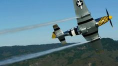 """Eddie Andreini P-51 ICAS 2012 by TimnEvan. Here's Eddie Andreini exercising his beautiful P-51 Mustang """"Primo Branco"""" and displaying the new smoke system he's developed."""