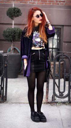Purple velvet button-up, cropped tee, high waisted black leather skirt.