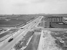 1950's. View of the Ookmeerweg in Amsterdam-West. The Ookmeerweg is a main road in Amsterdam Nieuw-West. The street was constructed in 1957 and formed at that time the northern border of the borough of Osdorp. The Ookmeerweg starts at the Sloterpark where the President Allendelaan ends and then runs in western direction. On the first part, at the north-side (left) is the Sportpark Ookmeelocated, interrupted by the Troelstralaan. On the south-side are homes. #amsterdam #1950 #Ookmeerweg
