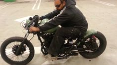 Green 250cc Honda Rebel Bobber.