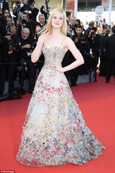 Prom queen! Elle Fanning wowed in a floral embellished tulle gown as she walked the red carpet at the Cannes Anniversary Soiree at the Palais des Festivals on Tuesday night