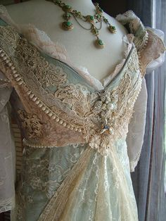 Original handmade gown using vintage,  antique, & new laces & appliqués, brooches, pearls, taffeta, Chantilly & other lace & beaded fabrics. $ 1,375 - via Etsy.