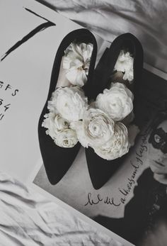 Black heels and white flowers