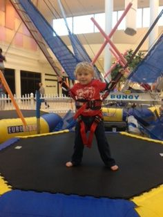 Aiden bungee  jumping at the mall