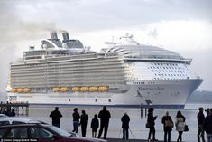 Welcome: A small crowd turned out to wave in the Harmony of the Seas as it sailed into Southampton shortly after 6am this morning