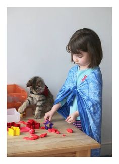 Thula plays along with Iris whether the Play-Doh is out… | How Thula The Cat Helps A Girl With Autism Live Life More Fully
