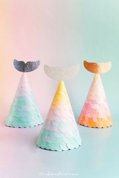 Mermaid Tail Party Hats For A Mermaid Birthday Party ⎜Make these gorgeous Mermaid Tail Party Hats for your little girls perfect Mermaid Themed Birthday Party! Find the FREE printable party hats + tailfin template on tinkerabout.com. They make great non-candy mermaid birthday party favors and are super easy to make. Find out how! #mermaidbirthdayparty #mermaidparty #kidsparty #partyhats #diyproject
