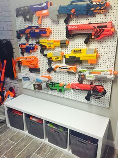 19 Unique Toy Storage Ideas for Kid's Playroom, Bedroom & Small Space Living Room 2019 Nerf Wall Nerf Gun Storage, Kid Toy Storage, Storage Ideas, Wall Storage, Children Storage, Storage Bins, Wall Shelves, Stuffed Toy Storage, Video Game Storage