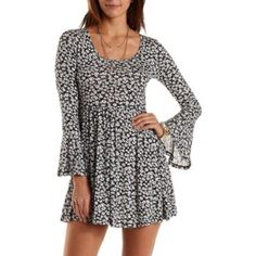 Charlotte Russe Bell Sleeve Dress Brand new with tags. Black and white floral bell sleeve babydoll dress from Charlotte Russe. Charlotte Russe Dresses Mini