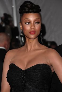 Tyra Banks Bun Hairstyle: Braided Extreme Top Bun | herinterest.com