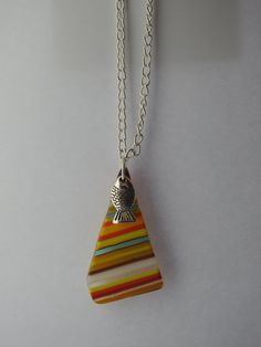 gorgeous multi coloured stripe recycled glass pendant with fish charm by…