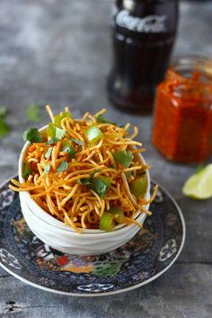 Chinese Bhel Recipe is one of our favorite Indo-Chinese appetizer recipes. It has trucks of crispy noodles, colorful vegetables, and the bold schezwan sauce. funfoodfrolic.com