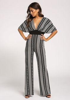 3c0ed1b5e8a2 The perfect night out jumpsuit featuring a plunge V front and back with a  single cross strap.