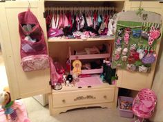 Turned wardrobe into American Girl organizer/house!