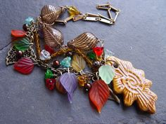 Rain on My Garden - Colorful Glass, Brass and Pottery Necklace. $42.50, via Etsy.