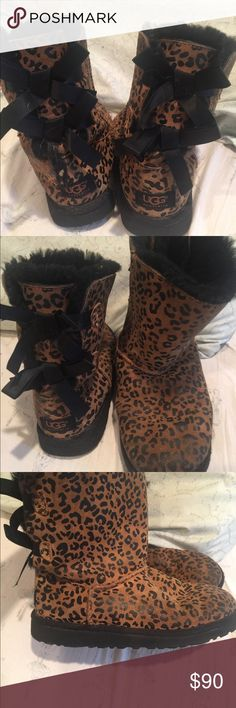 UGG LEOPARD PRINT SUEDE BOW BOOTS Authentic Ugg Australia leopard suede with thick black sheepskin fur on inside. Has a minor flaw on front shown in 7th pic but still in excellent condition. Size 4 youth will fit 5/6 woman. Beautiful satin bows in back. UGG Shoes Boots