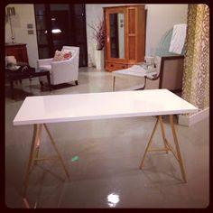 Linnmon table top in white $5.99 + Lerberg leg $10.00 each + spray paint can in the color of your choose $5
