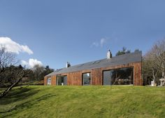 A449 converts Scottish cottage into writer's home with scorched larch cladding