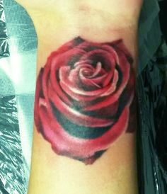 Red rose on left wrist. In remembrance of my Nana. Now you're close to my heart forever.