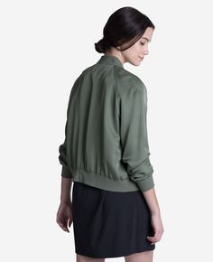 Just because it's getting cooler doesn't mean you need to put your silk away. Instead, wrap up in a silk bomber jacket that's fully lined, cropped just so, and ready when you are. Bomb(er)s away.  Outer shell crafted from pure Silk Georgette. Lined with 100% silk satin Ribbed cuff and collar for a refined finish and fit Double welt front pockets eliminate any bulk