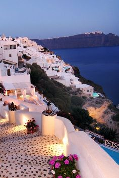 Santorini, Greece This at the top of my bucket list! In fact if I don't make here before I die, just scatter my ashes here; that'll work for me!