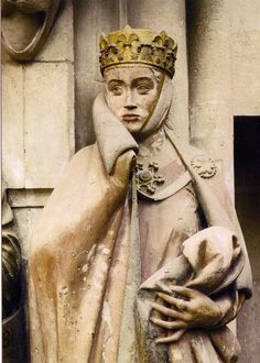 Countess Uta Eckhart drawing the collar of her cloak across her cheek. Naumberg Cathedral. ca. 1245. Gothic Sculpture