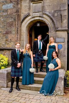 Bridesmaids and groomsmen always look good at Knockderry House Wedding photography in Glasgow by Ian Arthur