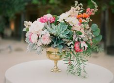 Succulents and beautiful flowers: http://www.stylemepretty.com/2014/09/10/vibrant-open-air-wedding-santa-barbara/   Photography: Diana McGregor - http://www.dianamcgregor.com/
