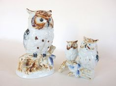 What a great vintage set! The ceramic owl family are in two pieces and represent a mother and two owlets. The white owl figurines are accented with