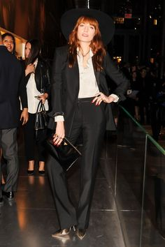 Florence Welch was dressed by Prada in a black satin suit and wide-brimmed hat.