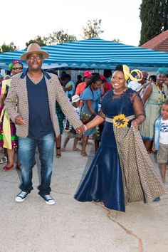 Blue and yellow shweshwe dress by Zodwa Bridals South Africa - Traditional Sesotho Dress worn by Mrs. African Fashion Skirts, African Wear Dresses, South African Fashion, African Fashion Designers, Africa Fashion, African Clothes, Wedding Dresses South Africa, African Wedding Attire, African Attire