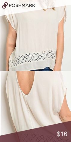 Blouse with Round Neck and Lace Trim This 95% rayon and 5% spandex blouse has an open back and lace trim inset.  Fit is true to size  Color is ivory Tops Blouses