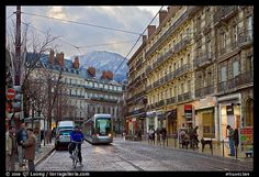 grenoble france | ... : Bicyclist and tramway next to Victor Hugo place. Grenoble, France