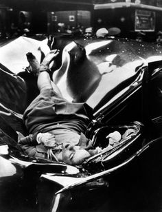 The body of 23-year-old Evelyn McHale rests atop a crumpled limousine minutes after she jumped to her death from the Empire State Building May 1, 1947