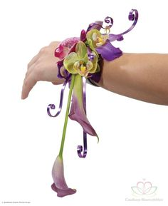 A very nice corsage with orchids.