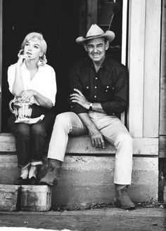 Marilyn Monroe and Clark Gable on the set of The Misfits, photographed by Dennis Stock, 1960.