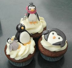 Penguin cupcakes! I saw these and though of your son Dolores. =D (omg.... These are so cute!!)