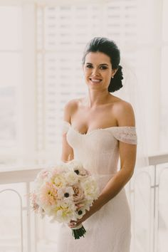 Off the shoulder Monique Lhuillier wedding dress: http://www.stylemepretty.com/georgia-weddings/atlanta/2014/11/10/sophisticated-atlanta-wedding-at-the-georgian-terrace-hotel/ | Photography: Paige Jones - http://paigejones.co/