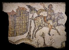 Mosaic pavement; stone; one of seven sections of a large pavement, whose hunting scenes formed the principal motif of a mosaic; horseman in front of a villa; in grey, black, white, bistre, red, pink, brown, blue and buff colours; large tree picked out in grey-green and dark blue; field has plants with red flowers. Excavated: Carthage, The mosaic comes from Bord-Djedid near the site of Carthage.