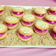 These absolutely remind me of baby shower food! White cookie monster style cookies with a big pink tongue and one tooth.  Why not?  Oh and they are resting on 'sand' - delicious!